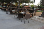 Елегантни и удобни маси и столове от тъмен ратан